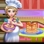 Беременная Эльза готовит торт